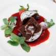 Stock Photo: Chocolate fondant with sweet berry sauce