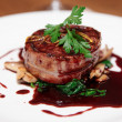 Tenderloin steak wrapped in bacon with red sauce  — ストック写真