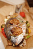 Dorade roasted in paper with vegetables — Stock Photo