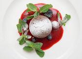 Chocolate fondant with sweet berry sauce — Stock Photo