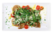 Rabbit ravioli with rocket salad isolated on white — Stock Photo