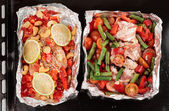Roasting pan with two uncooked dishes — Stockfoto