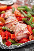 Chicken breast wrapped in bacon prior to baking — Stock Photo
