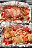 Two cooked dishes in foil — Stockfoto