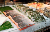 Fish steaks on market display — Stock fotografie