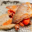 Seabass fillet cooked in Sicilian way — Stock Photo