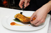 Chef is serving spiced slice of eggplant — Stock Photo