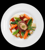 Tenderloin steak with vegetables and bone marrow isolated on bla — Stock Photo
