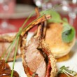 Rack of lamb with caramelized onions and bread — Stock Photo