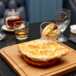 Meat pie on table in pub — Stock Photo