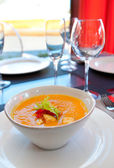 Hot pumpkin soup on table — Stock Photo