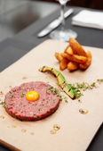 Beef tartare on restaurant table — Stock Photo