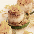 Pan fried scallops with citrus zest — Stock Photo #39489797