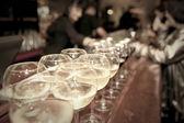 Wineglasses on bar counter — Stock Photo
