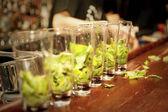 Highball glasses with mint - preparing mojitas — Stock Photo