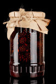 Glass jar with pine cones preserves — Stock Photo