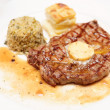Rib eye steak with bulgur, butter and potato gratin — Stock Photo
