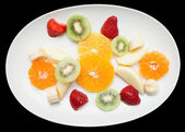 Fruit plate isolated on black — Stock Photo