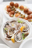 Fresh oysters and snacks — Stock Photo