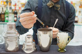 Bartender is making cocktail at bar counter — Stock Photo