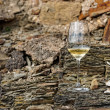 Glass of Riesling wine on slate rock — Stock Photo #47186293