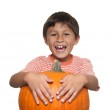 Smiling boy with pumpkin — Stock Photo #12171025