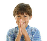 Young boy smiling with hands together — Stock Photo