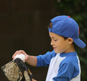 Hispanic boy playing with baseball and glove — Stock Photo