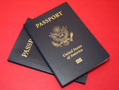 Passports on Matte Red Background — Stock Photo