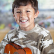 Boy with guitar — Stock Photo