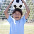 Stock Photo: Backlit boy with soccer ball