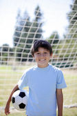 Backlit boy with Soccer ball — Stock Photo