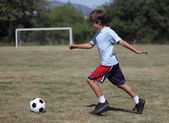 Boy playing soccer — Stock Photo