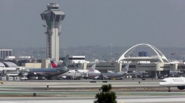 LOS ANGELES, CALIFORNIA, USA - SEPTEMBER 17: A plane taxis past the tower at Los Angeles International Airport on on September 17, 2012. In 2011, LAX was the sixth busiest airport in the world.