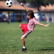Boy playing soccer or football in the park — Stock Photo