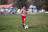 Boy playing soccer n the park — Stock Photo