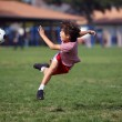 Boy playing soccer in the park — Stock Photo #17434515