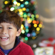 Smiling Boy in Front of Christmas Tree — Stock Photo