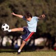 Young boy with soccer ball in park — Stock Photo
