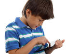 Boy using touch screen tablet — Stock Photo