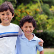 Two smiling happy young mixed race boys — Stock Photo #25539001
