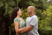 A happy mixed race couple — Stock Photo
