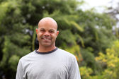 African american man poses outside in the park — Stock Photo