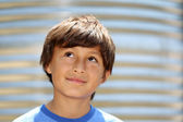 Young smiling boy outside — Stock Photo