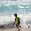 Young boy plays at the beach — Stock Photo