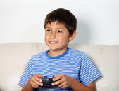 Young boy playing computer game — Stock Photo