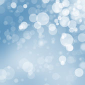 Christmas bokeh balls on blue background — Stock Photo