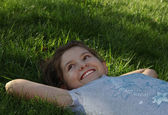 Girl having a rest on the grass — Stock Photo