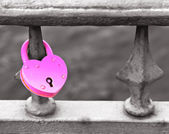 Pink padlock on the grille — Stock Photo