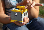Building in child hands — Stock Photo